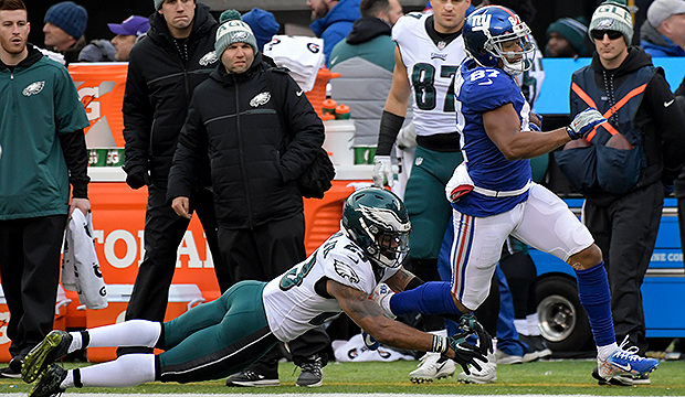 EAGLES CLINCH A FIRST ROUND BYE WITH WIN OVER GIANTS. BUT YOU MIGHT WANT TO HOLD OFF ON THECELEBRATIONS