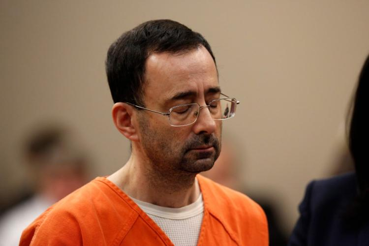 FORMER USA GYMNASTICS PHYSICIAN LARRY NASSAR SENTENCED TO 40-175 YEARS IN PRISON