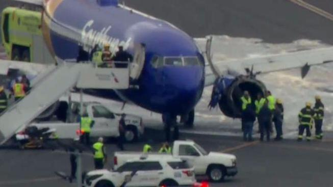 SOUTHWEST AIRLINES PLANE MAKES EMERGENCY LANDING AT PHILADELPHIA INTL. AIRPORT AFTER MID-AIRMALFUNCTION